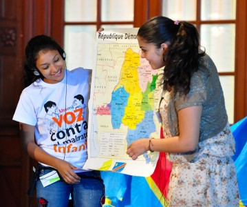 Two girls from different countries presenting on Democratic Republic of Congo, at the Children as Actors for Transforming Society Conference in 2013.