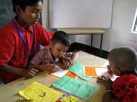 A Young Facilitator working with Young Learners in a Child to Child project in India.