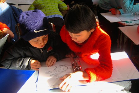 A Young Facilitator with a Young Learner in Tajikistan.