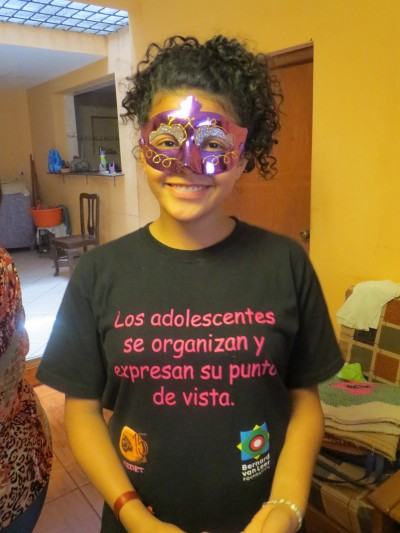 "The text on the tee-shirt reads: ""The adolescents get organised and express their opinions."""