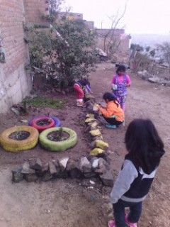 Children painting rocks to for the garden terraces